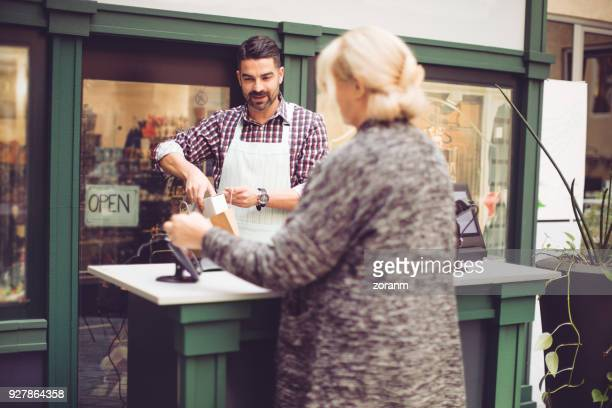 Senior woman paying with credit card