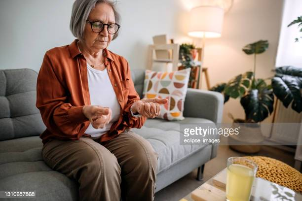 senior woman - osteoporosis stock pictures, royalty-free photos & images