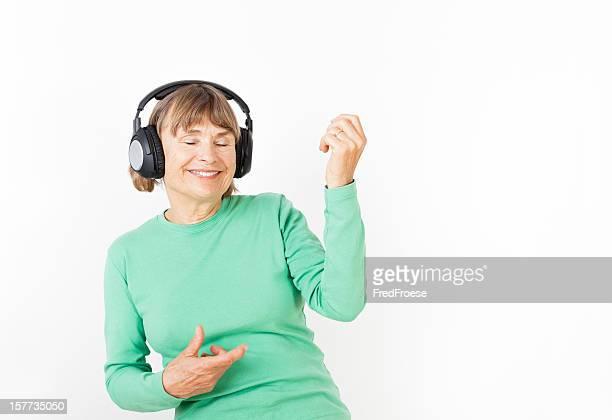 Senior woman playing air guitar