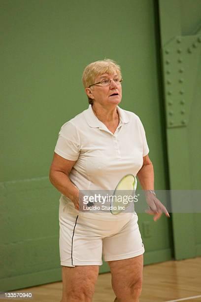 Senior woman playing badminton