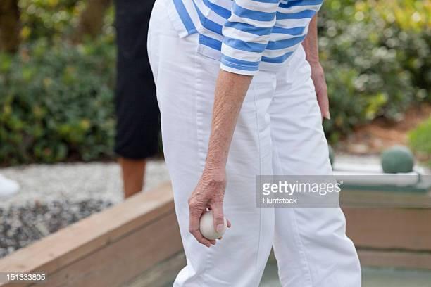 Senior woman playing bocce ball