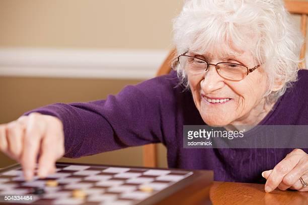 Senior Woman Playing Checkers