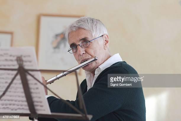 Senior woman playing flute