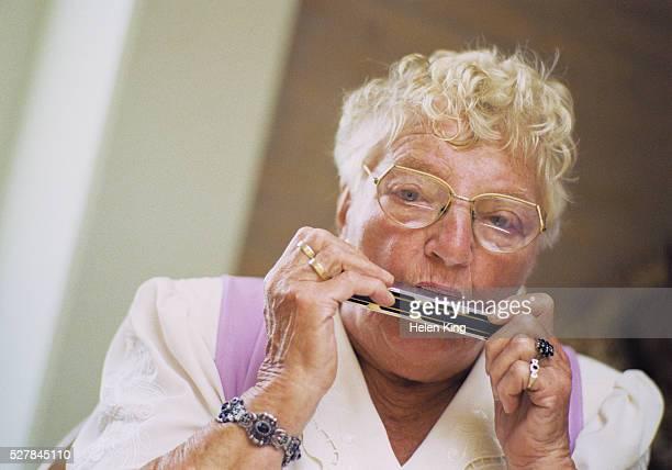 Senior Woman Playing Harmonica