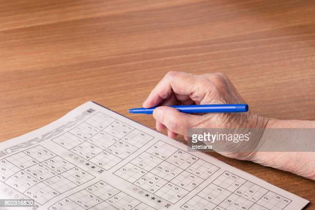Senior woman playing in sudoku game