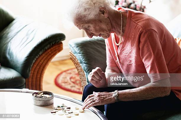 senior woman playing jigsaw puzzle