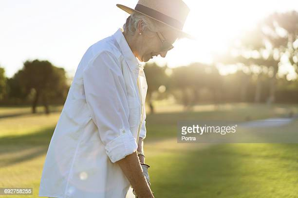 Senior woman playing on golf course
