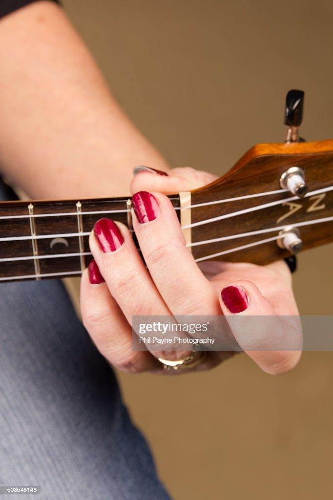 Senior Woman Playing Ukelele E7 Chord Stock Photo   Getty Images