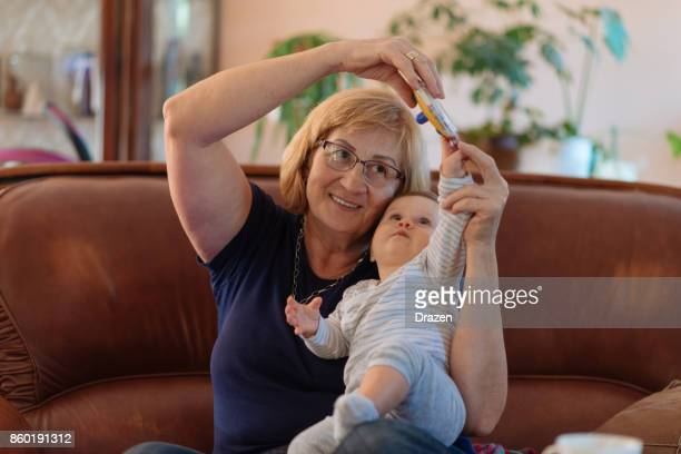 senior woman playing with baby - fat granny stock pictures, royalty-free photos & images