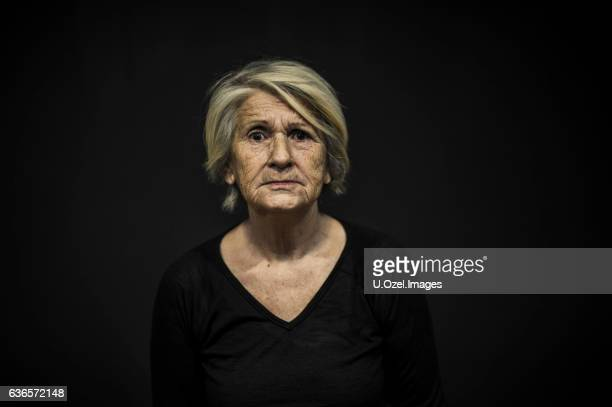 Senior Woman Portrait Front of a Black Background