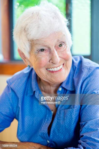 "senior woman portrait in summer house. - ""martine doucet"" or martinedoucet stock pictures, royalty-free photos & images"
