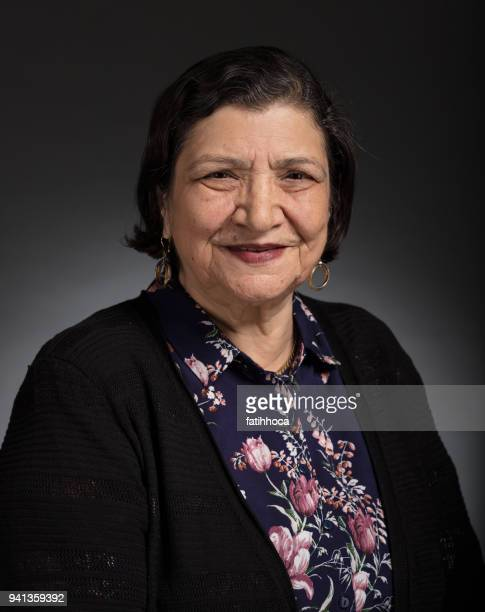 senior woman portrait - iranian culture stock photos and pictures
