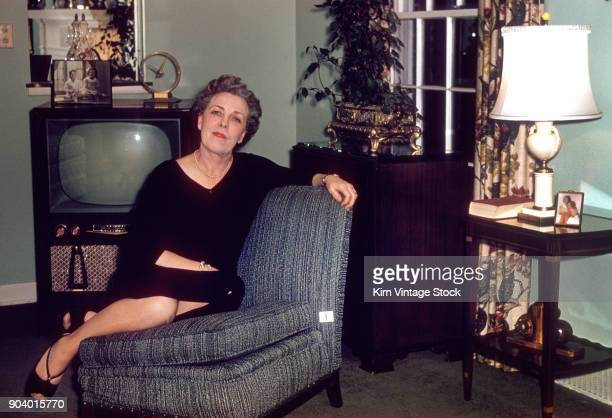 Senior woman poses in the living room, ca. 1954.