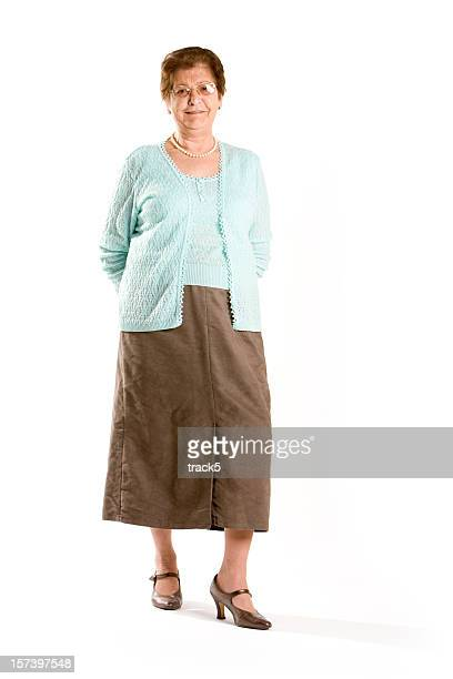 senior woman posing at the camera against a white background - blue skirt stock pictures, royalty-free photos & images