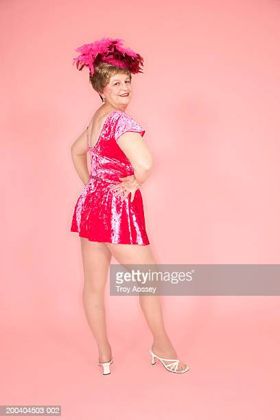 senior woman posing in dance costume, smiling, portrait - minirok stockfoto's en -beelden