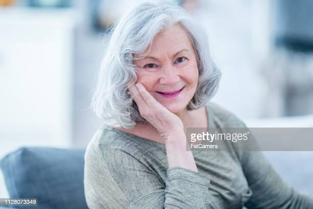 senior woman posing - fatcamera stock pictures, royalty-free photos & images