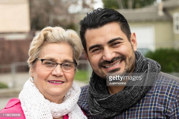 senior woman posing with her mid adult son - settler stock pictures, royalty-free photos & images