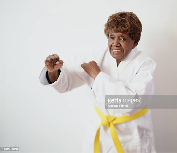 senior woman practicing karate - martial arts stock pictures, royalty-free photos & images