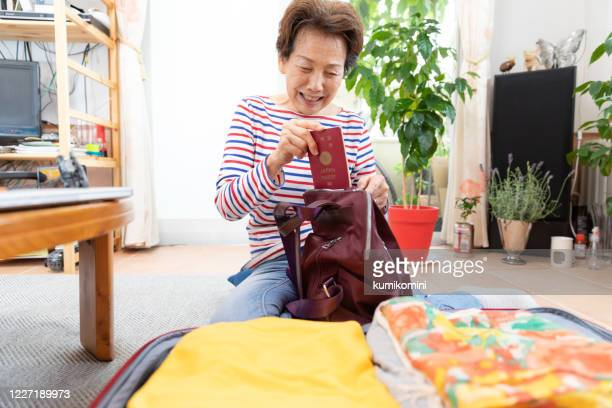 senior woman preparing for holiday - one senior woman only stock pictures, royalty-free photos & images