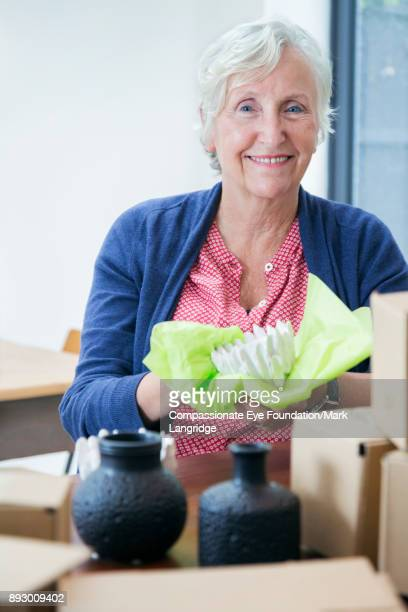Senior woman preparing parcel for shipment