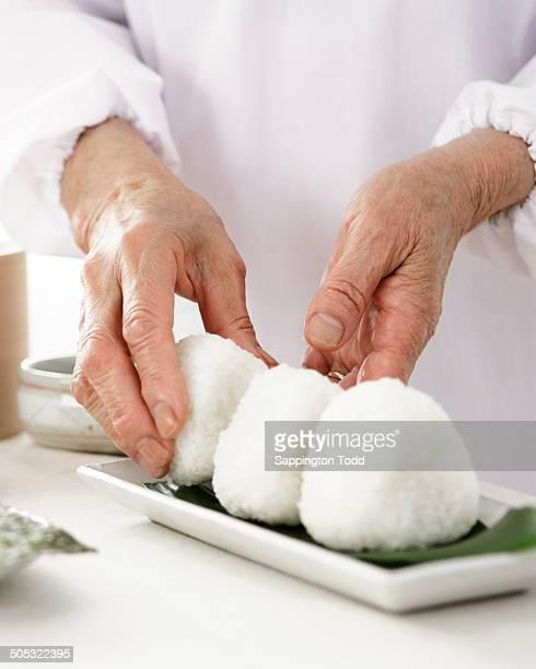 Senior Woman Preparing Rice Ball