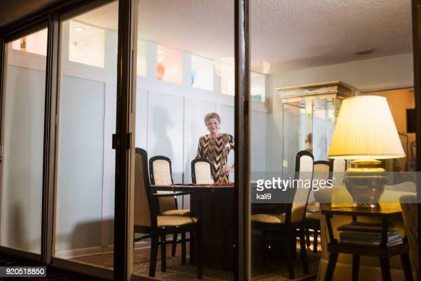 Senior woman preparing to host dinner party