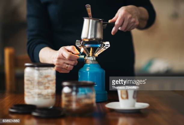 Senior woman preparing Turkish coffee