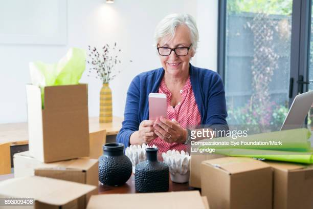 Senior woman processing orders in home office