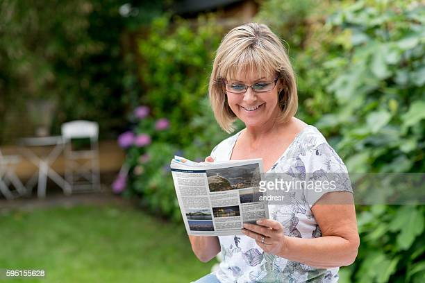 Senior woman reading the newspaper