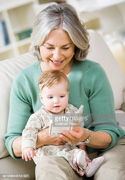 Senior woman reading to granddaughter (6 months)