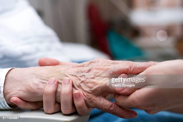Senior woman receiving hand massage