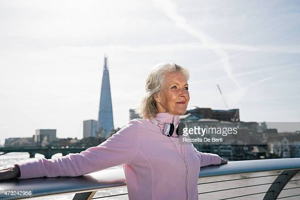 senior woman relaxing after workout - southwark stock pictures, royalty-free photos & images