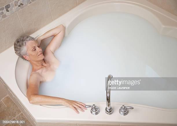 Senior woman relaxing in bath tub