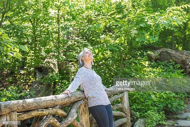 Senior woman relaxing in park