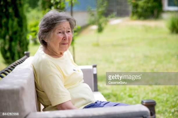 Senior Woman Relaxing In The Garden