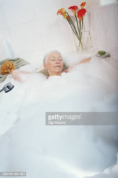 Senior woman relaxing in tub with eyes closed