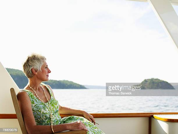 Senior woman relaxing on deck of yacht
