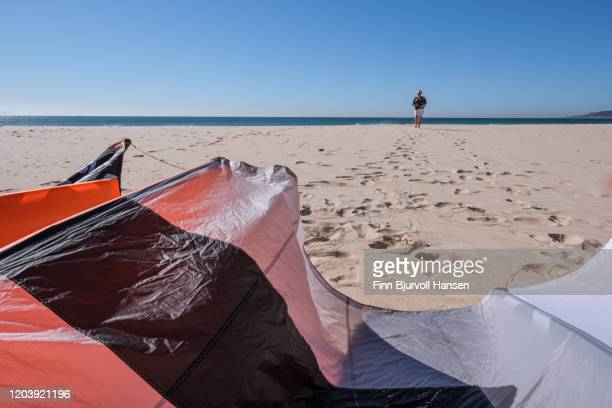 senior woman rigging lines for session of kitesurfing - finn bjurvoll photos et images de collection