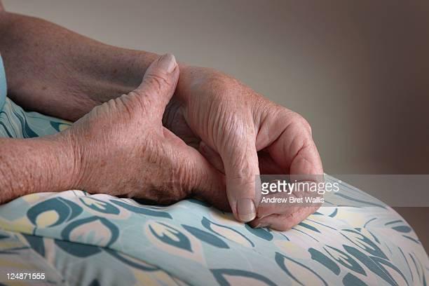 Senior woman rubbing a sore arthritic wrist