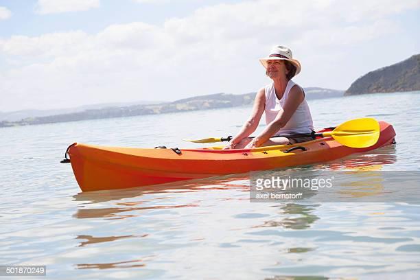 Senior woman sea kayaking