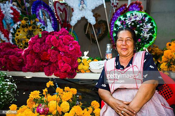 Senior woman selling flowers, San Juan Nuevo, Michoacan State, Mexico