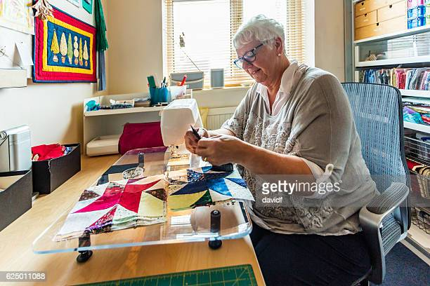 Senior Woman Sewing Quilts as a Craft Hobby