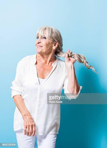 Senior woman shakes her hair