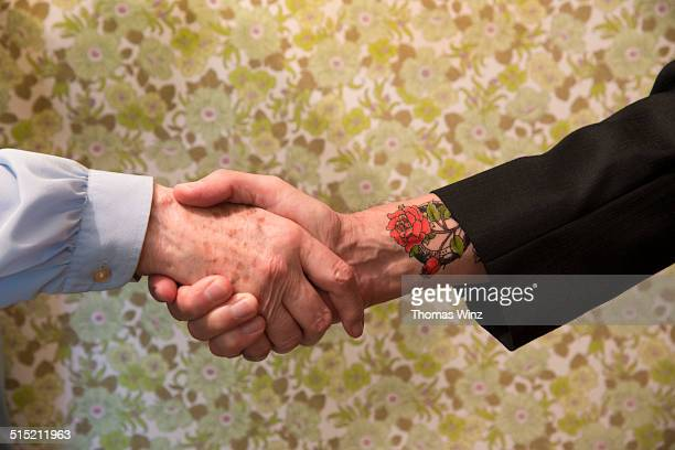 Senior woman shaking hands with a  man