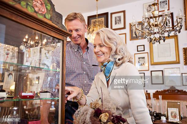 Senior woman shopping in an antiquity store