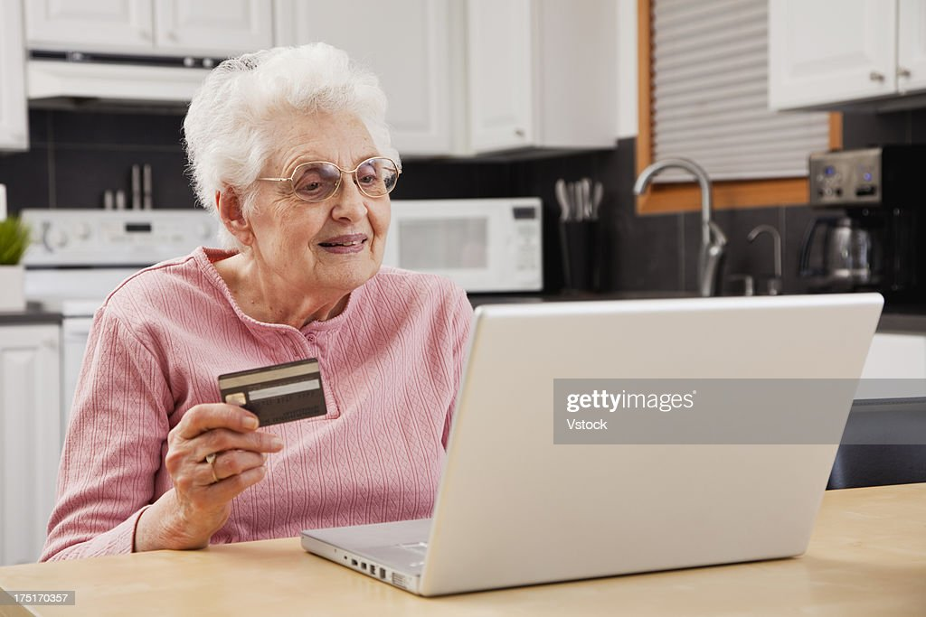 Senior woman shopping online : Stock Photo