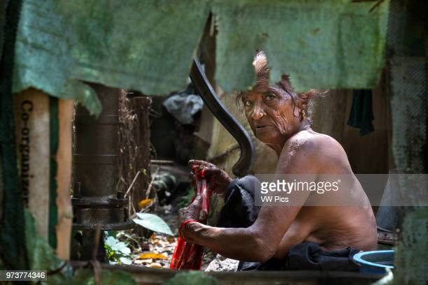 Senior woman showering Bharatpur Ratnanagar Chitwan National Park Nepal Asia