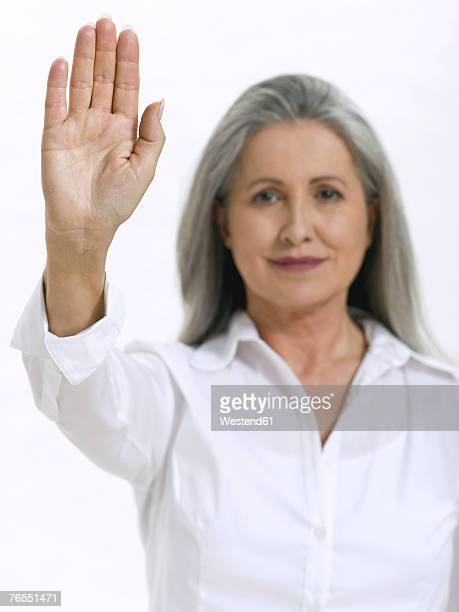 Senior woman showing palm