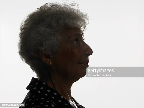 Senior woman silhouetted against white background, profile, head and shoulders