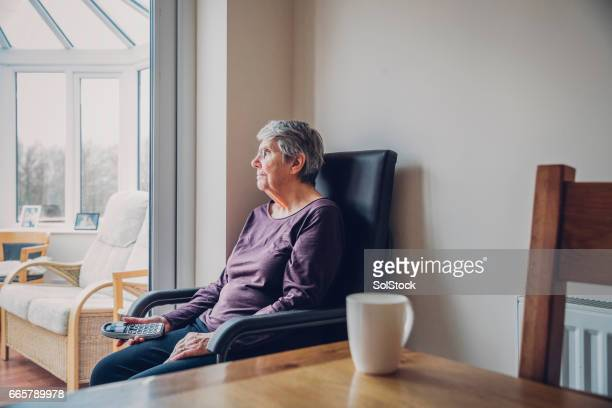 Senior Woman Sitting Alone